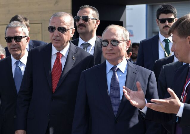 Russian President Vladimir Putin and Turkish President Recep Tayyip Erdogan (second from left) during a visit to the exposition of the International Airspace Show MAKS-2019.