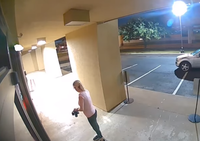 US woman caught on surveillance footage using a battery-powered grind saw to break into Botox clinic to steal anti-aging products.