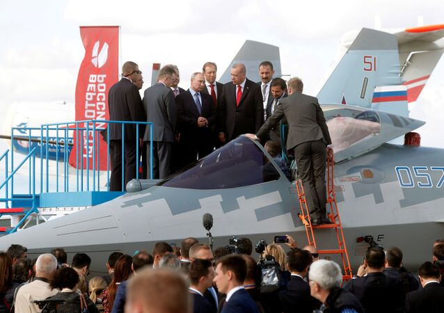 Russian President Vladimir Putin, Russian Industry and Trade Minister Denis Manturov and Turkish President Recep Tayyip Erdogan inspect a Sukhoi Su-57 fifth-generation fighter during the MAKS-2019 International Aviation and Space Salon in Zhukovsky outside Moscow, Russia, August 27, 2019