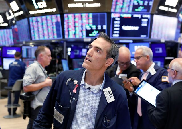 Traders work on the floor of the New York Stock Exchange shortly after the closing bell in New York, U.S., August 23, 2019