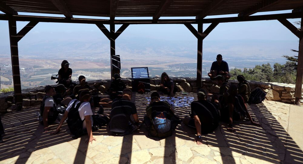 Israeli soldiers sit beneath a shade at an observation point overlooking Lebanon, near Kibbutz Misgav Am, in northern Israel, close to the border with Lebanon August 28, 2019