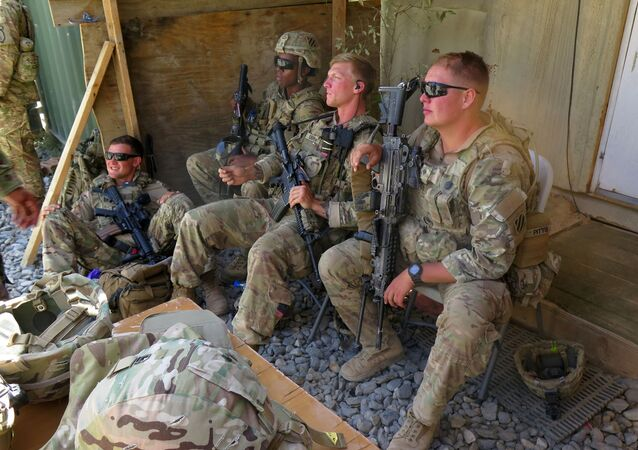 U.S. military advisers from the 1st Security Force Assistance Brigade sit at an Afghan National Army base in Maidan Wardak province, Afghanistan August 6, 2018
