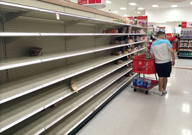 Shoppers encounter empty bread shelves at a store while buying supplies ahead of the arrival of Hurricane Dorian in Kissimmee, Florida, U.S. August 29, 2019.    REUTERS/Gregg Newton