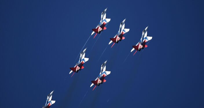 MiG-29 fighter jets piloted by the Swifts aerobatic team perform at the MAKS-2019 international air show in Zhukovsky, outside Moscow.