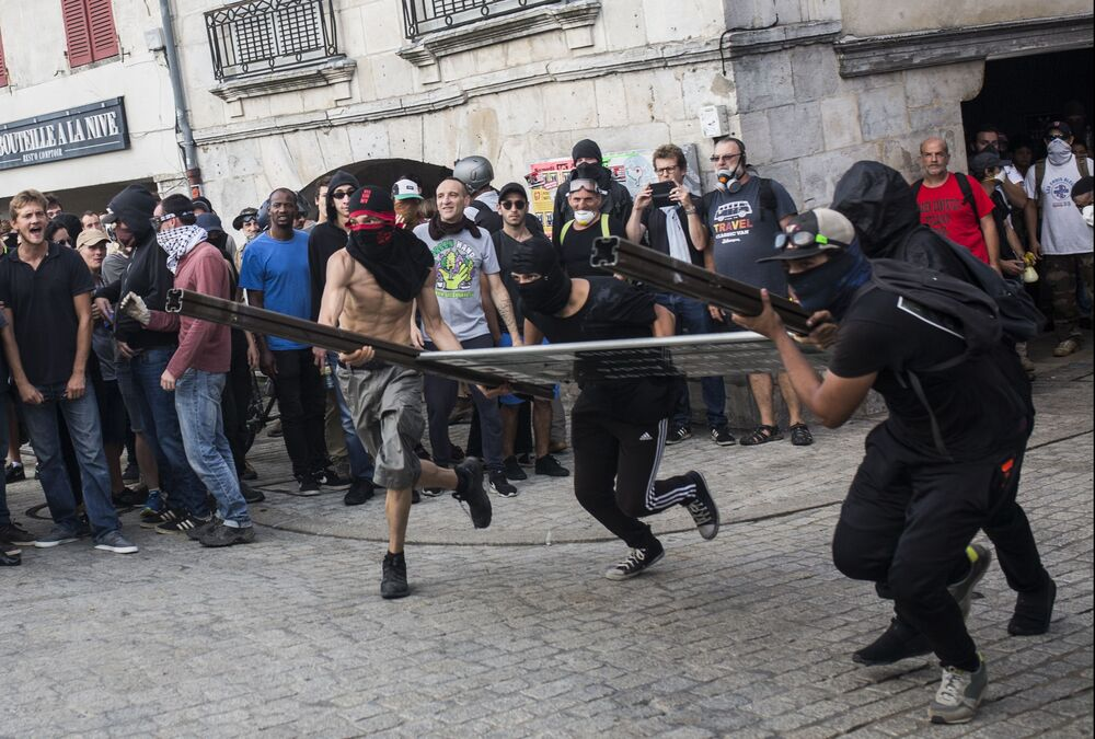Young men during the protests against the G7 summit in France.
