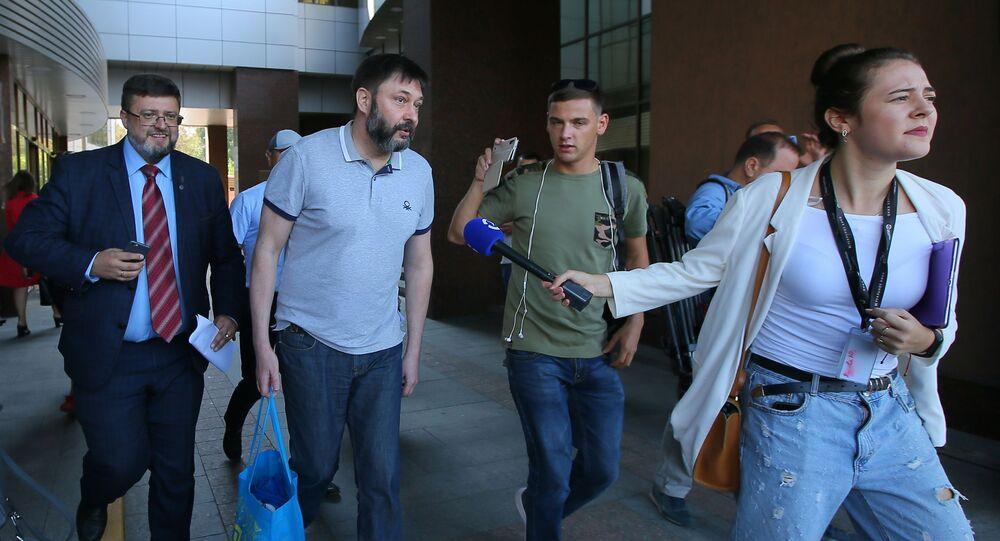 RIA Novosti Ukraine's Editor-in-Chief Kirill Vyshinsky near an appeals court's building in Kiev.