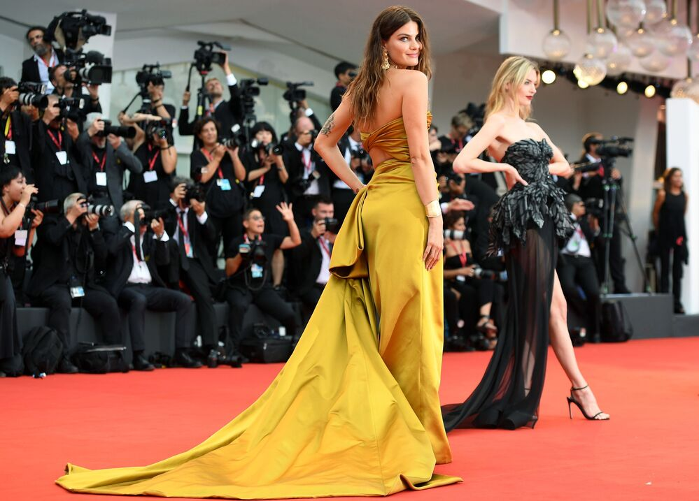 Brazilian supermodel Isabeli Fontana poses for a photo on the red carpet for the film La Verite (The Truth) ahead of the opening ceremony at the 76th Venice Film Festival