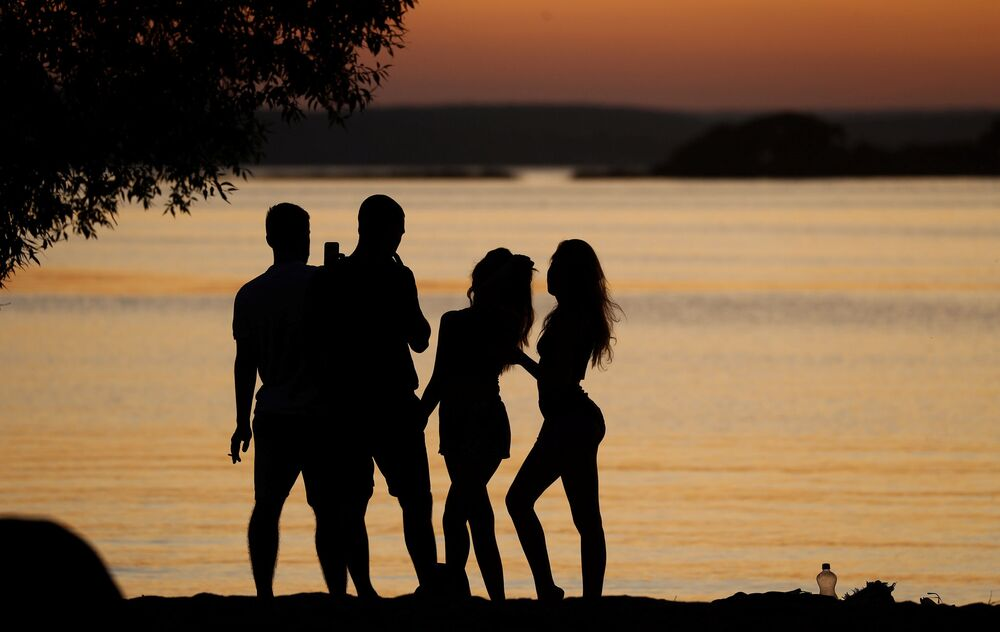 People enjoy sunset at a lake on the outskirts of Minsk, Belarus August 27, 2019.