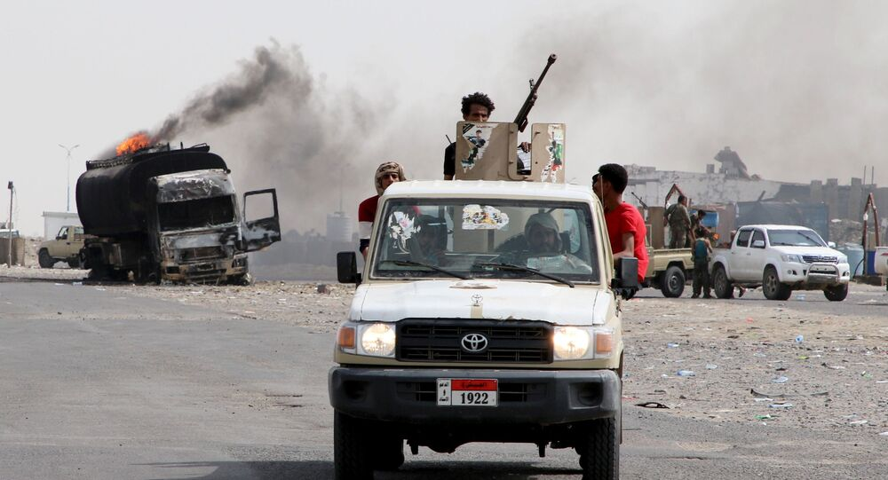 Southern separatist fighters patrol a road during clashes with government forces in Aden, Yemen August 29, 2019