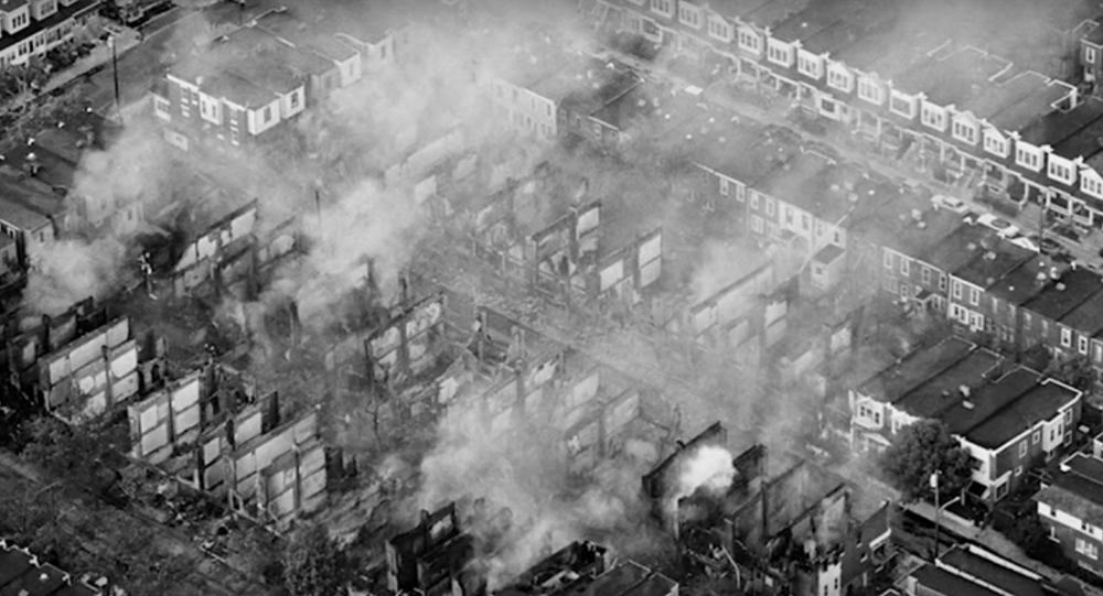 Photo of charred houses following the 1985 bombing of MOVE headquarters/home