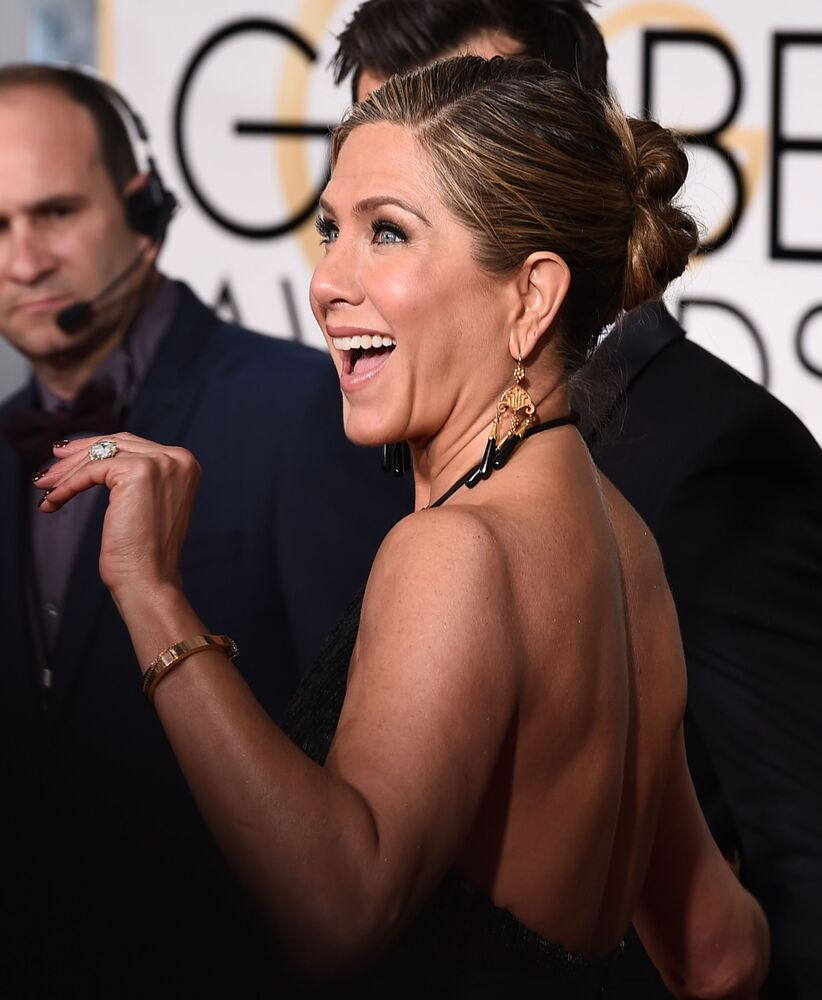 Jennifer Aniston arrives at the 72nd annual Golden Globe Awards at the Beverly Hilton Hotel on Sunday, Jan. 11, 2015, in Beverly Hills, Calif.