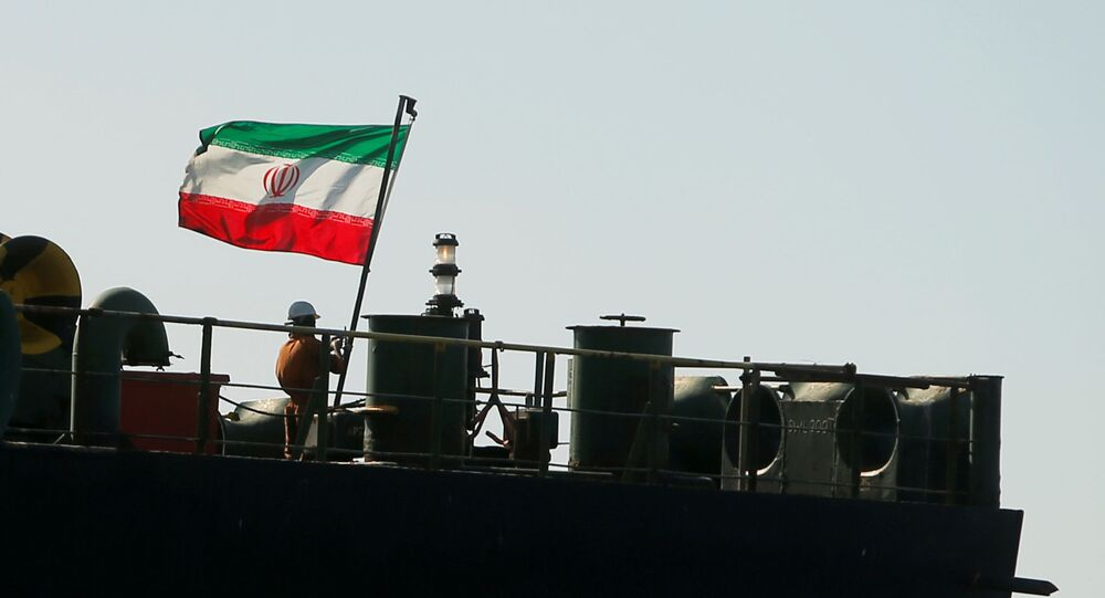 A crew member raises the Iranian flag on the Iranian oil tanker Adrian Darya 1, previously named Grace 1, as it sits anchored after the Supreme Court of the British territory Gibraltar lifted its detention order on 18 August 2019