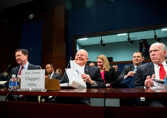 From left, then-FBI Director James Comey, then-Director of National Intelligence James Clapper, and then-CIA Director John Brennan arrive at a House Intelligence Committee hearing on world wide threats on Capitol Hill in Washington, Thursday, Feb. 25, 2016.