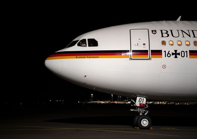The Konrad Adenauer Airbus A340 plane of the German government stands on the tarmac of Tegel airport in Berlin on April 1, 2019 before taking off with the German Foreign Minister onboard