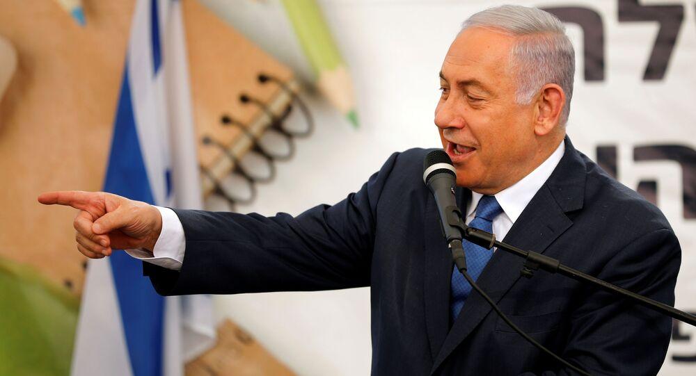 Israeli Prime Minister Benjamin Netanyahu gestures as he speaks during a ceremony opening the school year in the Jewish settlement of Elkana in the Israeli-occupied West Bank September 1, 2019.