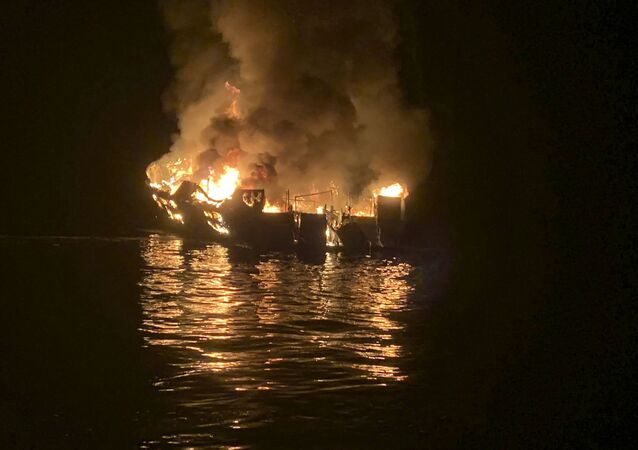 In this photo provided by the Santa Barbara County Fire Department, a dive boat is engulfed in flames after a deadly fire broke out aboard the commercial scuba diving vessel off the Southern California Coast, Monday morning, Sept. 2, 2019