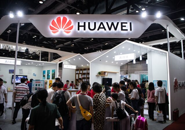 In this file photo taken on August 2, 2019 Attendees visit a Huawei exhibition stand during the Consumer Electronics Expo in Beijing