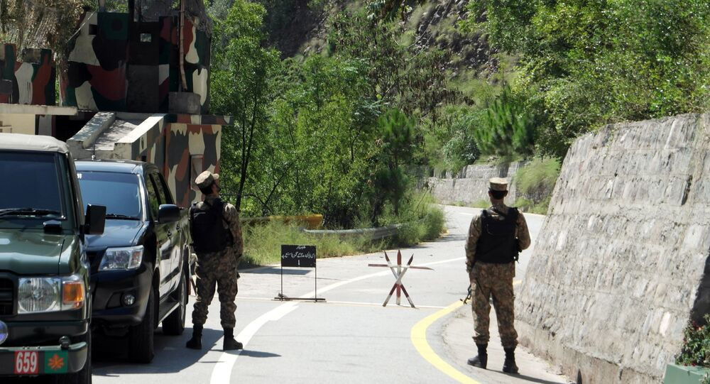 Army soldiers stand guard the Uri crossing point during a visit by journalists (unseen) on the Line of Control (LoC) in Chakothi, Pakistan-administered Kashmir, August 29, 2019