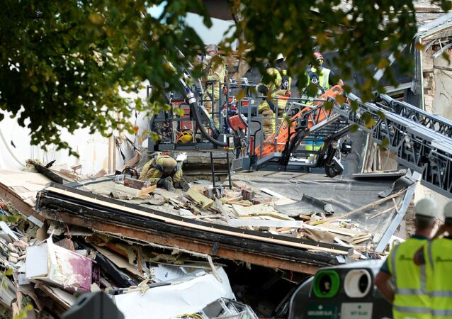 Emergency crews search at the site of an explosion, which destroyed a number of houses on the outskirts of the port city of Antwerp, Belgium, Septmeber 3, 2019