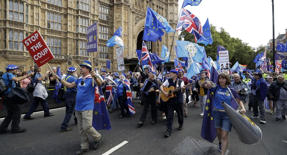 Members of a pro-EU band perform as they protest outside the Houses of Parliament in London, Tuesday, Sept. 3, 2019