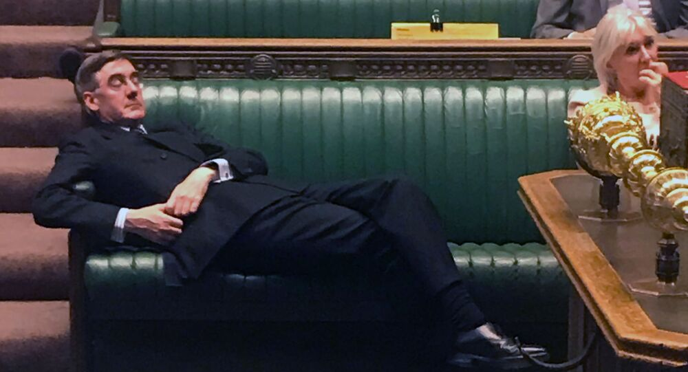 This handout picture released on the Twitter page of British Labour party MP for Redcar, Anna Turley, shows shows Britain's Leader of the House of Commons Jacob Rees-Mogg relaxing on the front benches during the Standing Order 24 emergency debate on a no-deal Brexit in the House of Commons in London on September 3, 2019