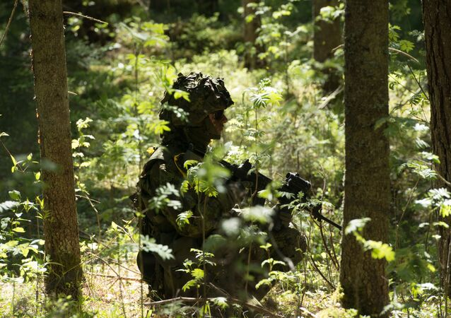 Estonian soldiers take part in an annual military exercise together with several units from other NATO member states on May 18, 2014 near Voru close to the Estonian-Russian border in South Estonia.