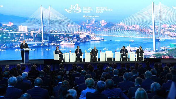 Russian President Vladimir Putin opens a plenary session of Eastern Economic Forum at far-eastern Russian port of Vladivostok on September 5, 2019 - Sputnik International