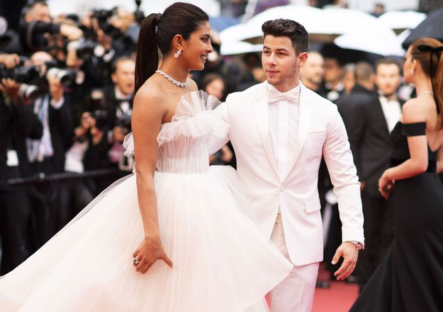 Actress Priyanka Chopra, left, and Nick Jonas pose for photographers upon arrival at the premiere of the film 'The Best Years of a Life' at the 72nd international film festival, Cannes, southern France, Saturday, May 18, 2019