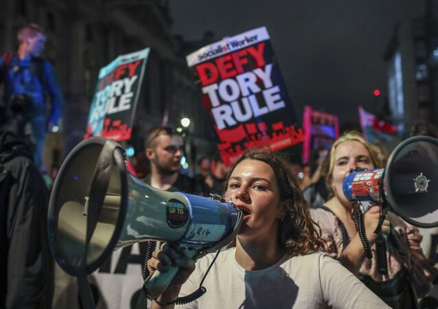 Protesters outside the House of Commons, London, Tuesday, Sept. 3, 2019