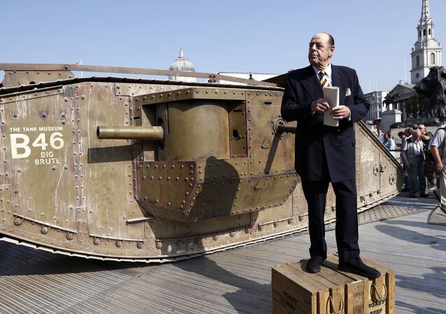 Sir Nicholas Soames, grandson of war-time prime minister Winston Churchill, gives an impromptu speech beside a British Mark IV tank in Trafalgar Square in central London, on September 15, 2016, during a photocall to mark 100 years to the day since they were first used in action during World War One. - 100 years ago today, Britain sent tanks onto the front line for the very first time as part of the country's Somme Offensive in 1916, at the Battle of Flers-Courcelette