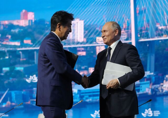 Russian President Vladimir Putin shakes hands with Japanese Prime Minister Shinzo Abe after a plenary session of the Eastern Economic Forum in Vladivostok, Russia September 5, 2019