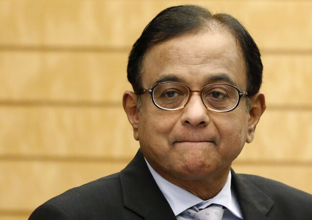 India's Finance Minister Palaniappan Chidambaram waits for the arrival of Japan's Prime Minister Shinzo Abe before their meeting at Abe's official residence in Tokyo on 1 April 2013