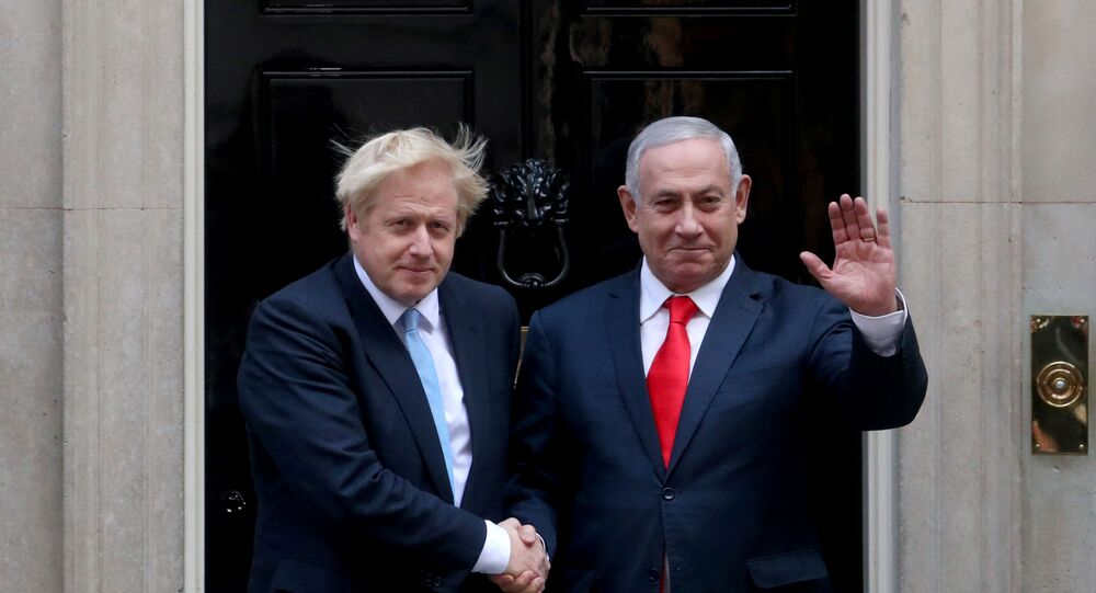 Britain's Prime Minister Boris Johnson welcomes Israel's Prime Minister Benjamin Netanyahu outside Downing Street in London, Britain September 5, 2019