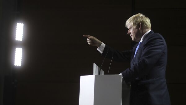 Britain's Prime Minister Boris Johnson gestures as he speaks during a press conference on the third and final day of the G-7 summit in Biarritz, France Monday, Aug. 26, 2019 - Sputnik International
