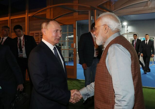 Russian President Vladimir Putin and Indian Prime Minister Narendra Modi pose for a picture with participants while touring an exhibition on the sidelines of the Eastern Economic Forum in Vladivostok, Russia September 4, 2019