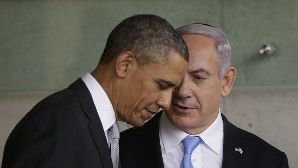 In this 22 March 2013 file photo, US President Barack Obama, left, listens to Israeli Prime Minister Benjamin Netanyahu during their visit to the Children's Memorial at the Yad Vashem Holocaust memorial in Jerusalem - Sputnik International