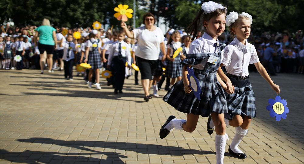 First-grade pupils during a festive gathering dedicated to Knowledge Day at school No 11 in Russia's city of Krasnodar.