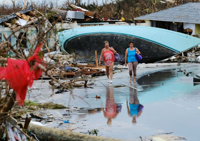 Women walk through the rubble in the aftermath of Hurricane Dorian on the Great Abaco island town of Marsh Harbour, Bahamas, September 3, 2019.