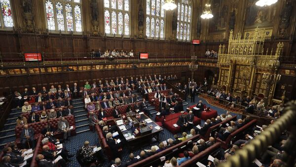 Lord Norman Fowler, the new Lord Speaker, left, speaks in the House of Lords chamber during his first sitting, in Parliament, London, Monday, Sept. 5, 2016 - Sputnik International