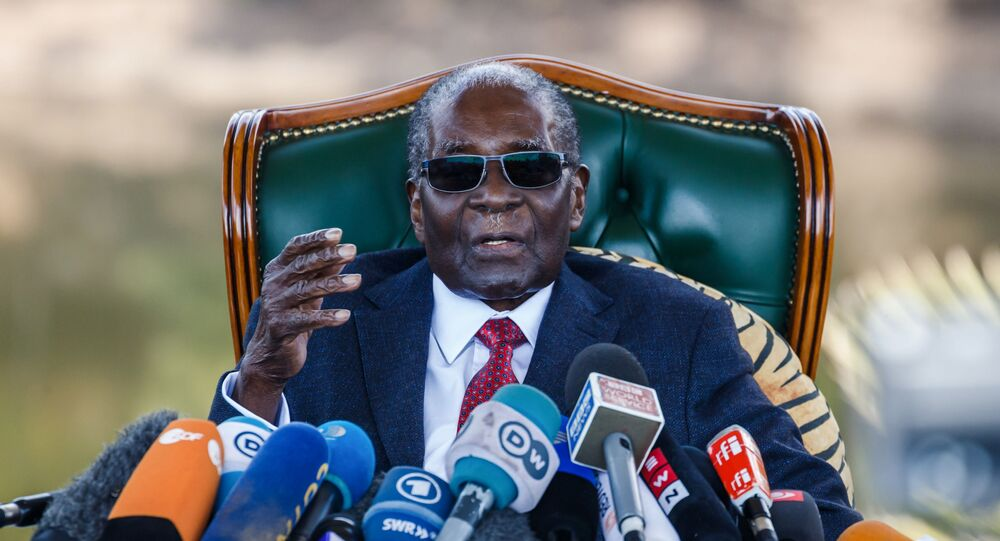 (FILES) In this file photo taken on July 29, 2018 Former Zimbabwean President Robert Mugabe addresses media during a surprise press conference at his residence Blue Roof  in Harare