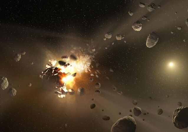 An artist's concept of catastrophic collisions between asteroids located in the belt between Mars and Jupiter.