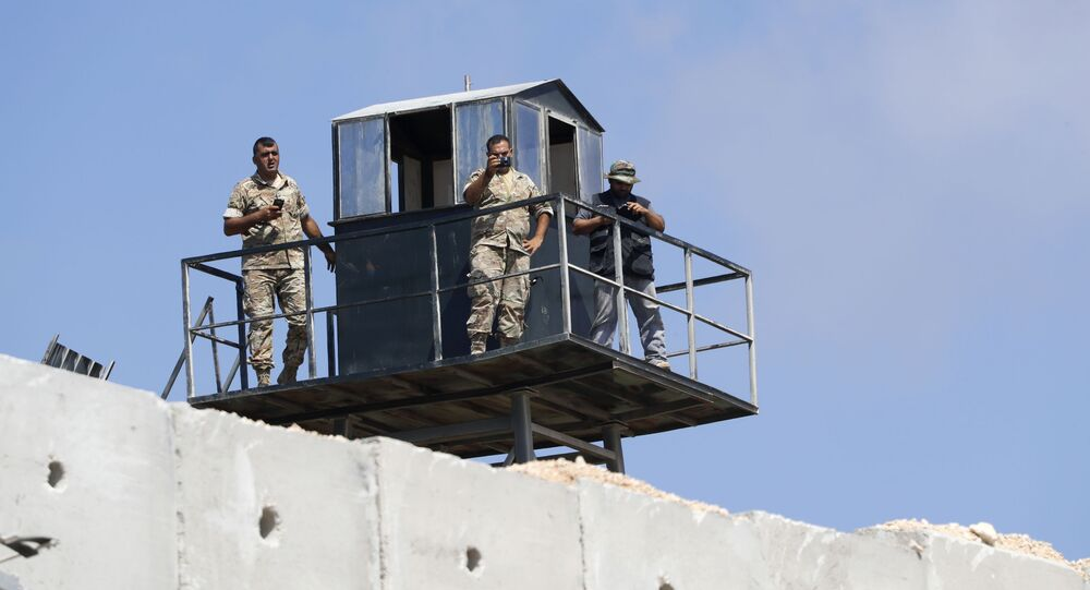 Lebanese soldiers on a watch tower along a new wall on the Israeli-Lebanese border (File)