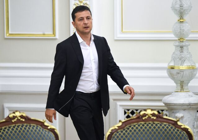 Ukrainian President Volodymyr Zelensky arrives for a meeting with the new members of the government and new president of Parliament, in Kiev on September 2, 2019