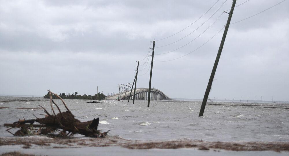 Storm surge from Hurricane Dorian blocks Cedar Island off from the mainland on NC 12 in Atlantic Beach, N.C., after Hurricane Dorian past the coast on Friday, Sept. 6, 2019. (AP Photo/Tom Copeland)