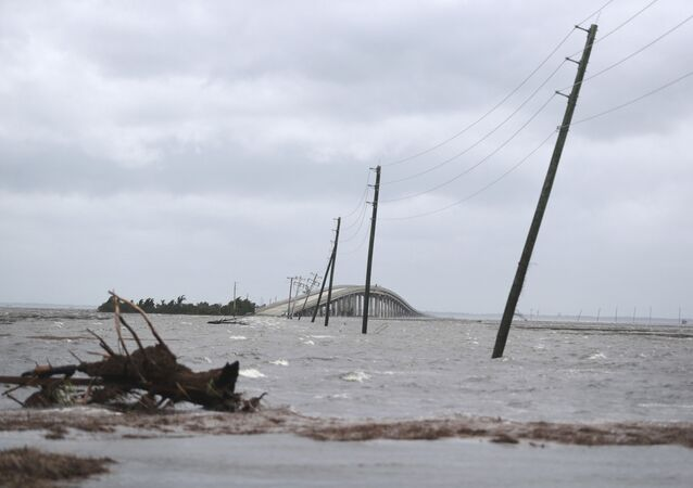 Storm surge from Hurricane Dorian blocks Cedar Island off from the mainland on NC 12 in Atlantic Beach, N.C., after Hurricane Dorian past the coast on Friday, Sept. 6, 2019. (AP Photo/Tom Copeland)