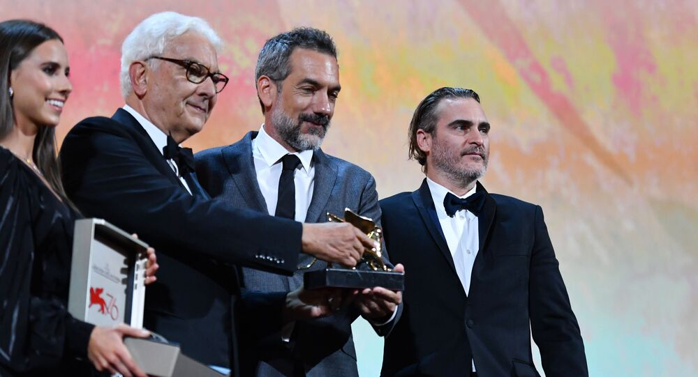 US director Todd Phillips (C), flanked by US actor Joaquin Phoenix (R) and President of the Venice Biennale Paolo Baratta, holds the Golden Lion award for Best Film he received for the movie Joker during the awards ceremony of the 76th Venice Film Festival on September 7, 2019 at Venice Lido.
