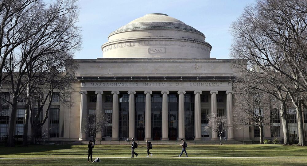 In this April 3, 2017 file photo, students walk past the Great Dome atop Building 10 on the Massachusetts Institute of Technology campus in Cambridge, Mass.