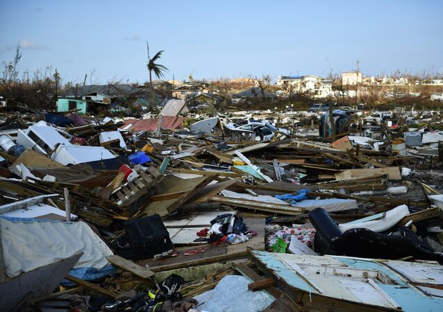 Belongings litter the ground in the Mudd neighborhood of Marsh Harbour, Great Abaco, on September 7, 2019, in the aftermath of Hurricane Dorian.