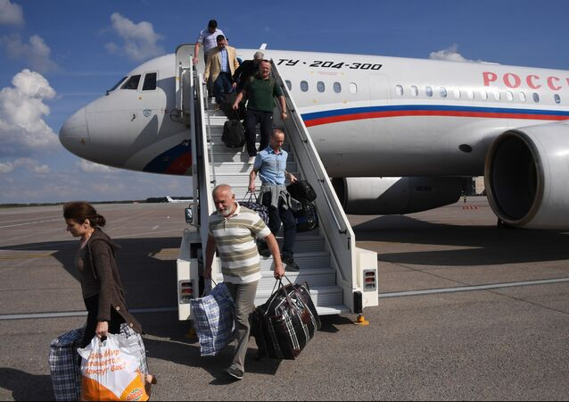 Participants of a simultaneous release of detainees agreed between Russia and Ukraine leave the plain upon arrival from Kiev to Moscow at the Vnukovo airport, outside Moscow, Russia