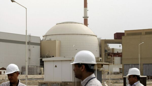 In this file photo taken on February 25, 2009, Iranian technicians walk outside the building housing the reactor of Bushehr nuclear power plant at the Iranian port town of Bushehr, 1200 Kms south of the capital Tehran. - Sputnik International